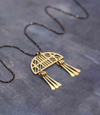 Long golden mobile necklace