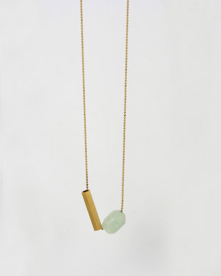 Long geometric necklace with a gemstone