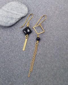 Golden black asymmetric tassel drops earrings